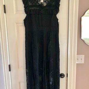 Mid-length black lace dress.